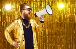 Marketing, sales and discounts concept. Man in shiny jacket, gold chain and sunglasses shouting in megaphone. Movie director or music producer with loudspeaker announces start of casting or audition
