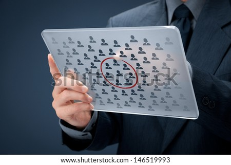 Marketing segmentation concept - businessman with futuristic glass tablet select segment (niche) of customers. Sales force team concept.