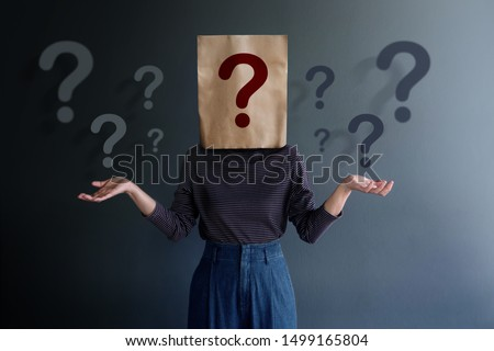 Marketing Strategy and Business Relationship Concept. Know Your Customer. Young Client on Covered Bag with Many Question Marks Foto stock ©