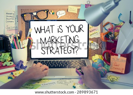 Marketing Strategy Concept / What is your marketing strategy note on laptop screen in office