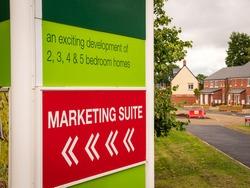 marketing suite showroom sign over new build housing estate.