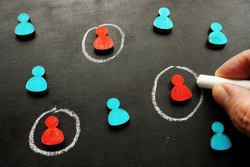 Marketing targeting and customer selection concept. The hand is tracing the figures.