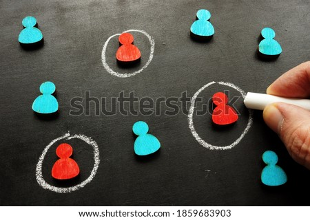 Marketing targeting and customer selection concept. The hand is tracing the figures. ストックフォト ©