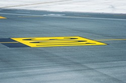 Marking for ground transportation on the airport apron among taxiways