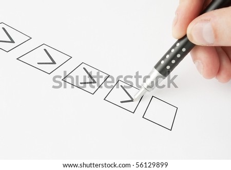 Marking in a Check box with pen - stock photo