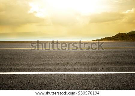 Marking line on asphalt road with sunlight