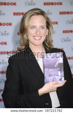 Marlee Matlin, holding copy of her book Deaf Child Crossing\