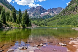 Maroon Bells and Maroon Lake - A wide-angle view of Maroon Bells at Maroon Lake on a sunny Summer day. Aspen, Colorado, USA.