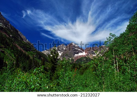 Maroon Bells Mountain Peaks in the summer with a majestic sky