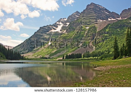 Maroon Bells with mirror reflection in Crater Lake