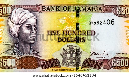 Photo of Maroons (Queen Nanny; Granny Nanny), a National Hero of Jamaica Portrait from Jamaica 500 Dollars 2003 Banknotes. An Old paper banknote, vintage retro. Famous ancient Banknotes. Collection.