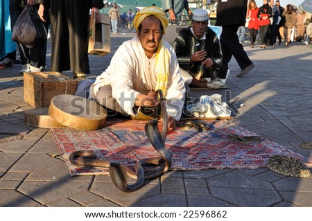 MARRAKECH, MOROCCO - NOV 22:  Snake charmer at Djemaa el Fna square.  November 22, 2008 in Marrakech, Morocco