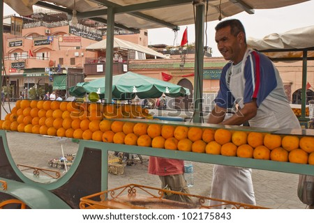 MARRAKESH, MOROCCO - AUGUST 8: Unidentified juice seller at the Jema el Fna Square in Marrakesh on August 8, 2010 in Marrakesh, Morocco. The square is part of the UNESCO World Heritage.