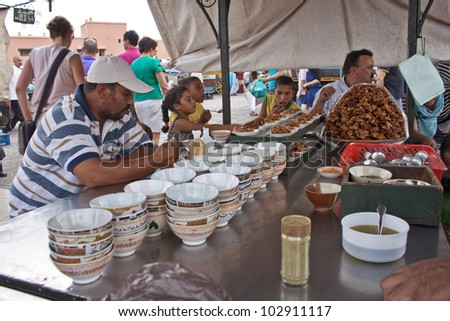 MARRAKESH, MOROCCO - AUGUST 8: Unidentified people eat at a stall at the Jema el Fna Square in Marrakesh on August 8, 2010 in Marrakesh, Morocco. The square is part of the UNESCO World Heritage.