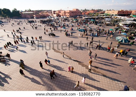MARRAKESH, MOROCCO - JAN 27: People walking at famous Marrakesh square Djemaa el Fna on January 27, 2010 in Marrakesh, Morocco. The square is part of the UNESCO World Heritage.