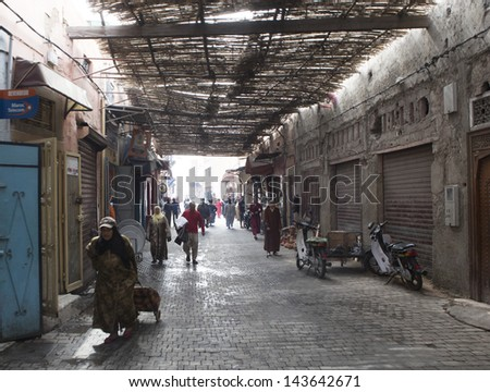 MARRAKESH ,MOROCCO - JUNE 4: Unidentified people at a street in Marrakesh on June 4, 2013 in Marrakesh. In 2009 the medina got part of UNESCO World Heritage.