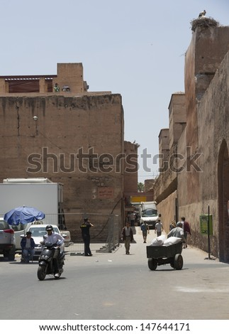 MARRAKESH ,MOROCCO - JUNE 4: Unidentified people at a street in Marrakesh on June 4, 2013 in Morocco. In 2009 the medina got part of UNESCO World Heritage.