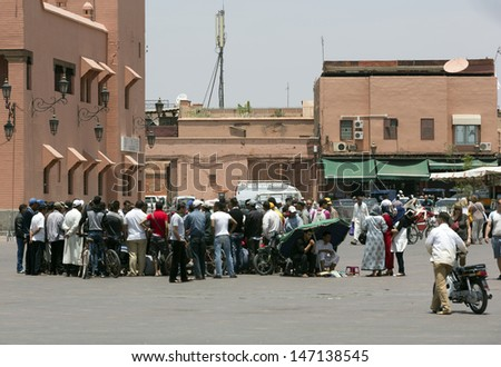 MARRAKESH ,MOROCCO - JUNE 4: Unidentified people visit the Djemaa el Fna square in Marrakesh on June 4, 2013 in Morocco. The square is part of UNESCO World Heritage.