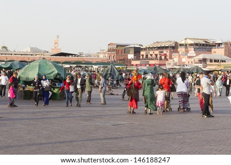 MARRAKESH, MOROCCO - JUNE 3: Unidentified people visit the Jemaa el Fna Square on June 3, 2013 in Marrakesh, Morocco. The square is part of the UNESCO World Heritage.