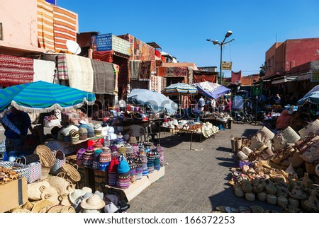 MARRAKESH, MOROCCO - NOVEMBER 14: on the square of the spices in the medina with unidentified people on November 14, 2013 in Marrakesh. The whole medina is protected by the UNESCO world heritage.