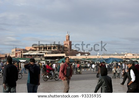 MARRAKESH, MOROCCO - NOVEMBER 3: Unidentified people visit the Jema el Fna Square in Marrakesh on November 3, 2007 in Marrakesh, Morocco. The square is part of the UNESCO World Heritage.