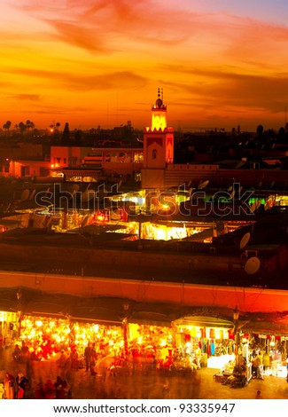 MARRAKESH, MOROCCO - NOVEMBER 3: Unidentified people watching the sunset on the Jema el Fna Square on November 3, 2007 in Marrakesh, Morocco. The square is part of the UNESCO World Heritage.