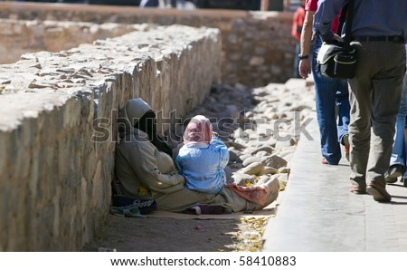 MARRAKESH, MOROCCO - OCTOBER 27: Beggar with her child near the Koutoubia mosque on October 27, 2008 in Marrakesh, Morocco.