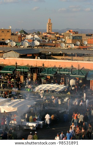 MARRAKESH, MOROCCO - OCTOBER 28: Famous Marrakesh square Djemaa el Fna and city roof on October 28, 2007 in Marrakesh, Morocco. The square is part of the UNESCO World Heritage. - stock photo