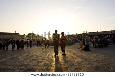 MARRAKESH, MOROCCO - OCTOBER 27: Local habitants wait for the sunset on the Jema el Fna square on October 27, 2008 in Marrakesh, Morocco.