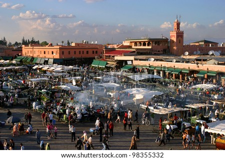MARRAKESH, MOROCCO - OCTOBER 28: People walking and shopping in famous Marrakesh square Jema el Fna on October 28, 2007 in Marrakesh, Morocco. The square is part of the UNESCO World Heritage.