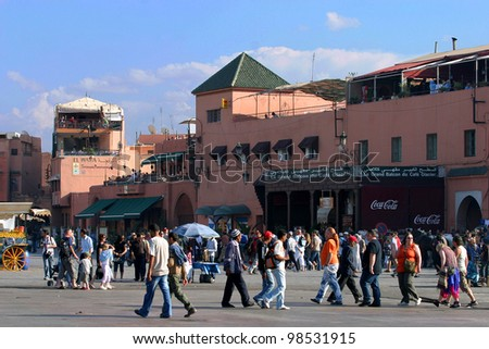 MARRAKESH, MOROCCO - OCTOBER 28: People walking at famous Marrakesh square Djemaa el Fna on October 28, 2007 in Marrakesh, Morocco. The square is part of the UNESCO World Heritage.