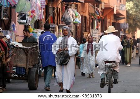 MARRAKESH, MOROCCO - OCTOBER 28: People walking in bazaar at famous Marrakesh square Djemaa el Fna on October 28, 2007 in Marrakesh, Morocco. The square is part of the UNESCO World Heritage.