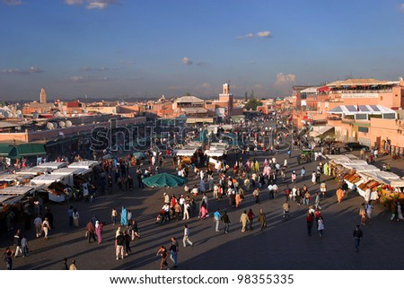 MARRAKESH, MOROCCO - OCTOBER 28: People walking in famous Marrakesh square Jema el Fna on October 28, 2007 in Marrakesh, Morocco. The square is part of the UNESCO World Heritage.