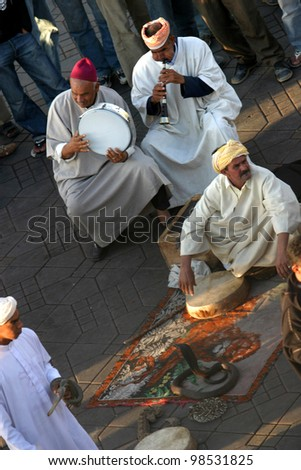 MARRAKESH, MOROCCO - OCTOBER 28: Snake charmer at famous Marrakesh square Djemaa el Fna on October 28, 2007 in Marrakesh, Morocco. The square is part of the UNESCO World Heritage.