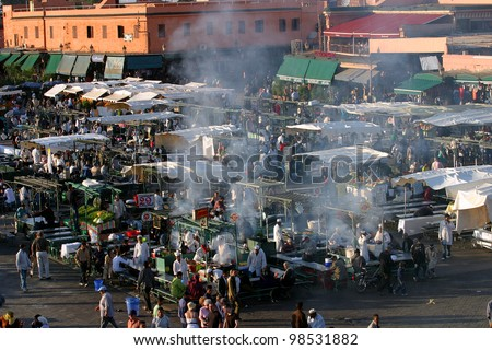 MARRAKESH, MOROCCO - OCTOBER 28: Street shopping area and famous Marrakesh square Djemaa el Fna on October 28, 2007 in Marrakesh, Morocco. The square is part of the UNESCO World Heritage.