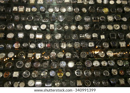 MARRAKESH, MOROCCO, SEP 19: Group of Fake watches displayed in a retail shop in the market of the traditional Medina in Marrakesh at night. Morocco 2006