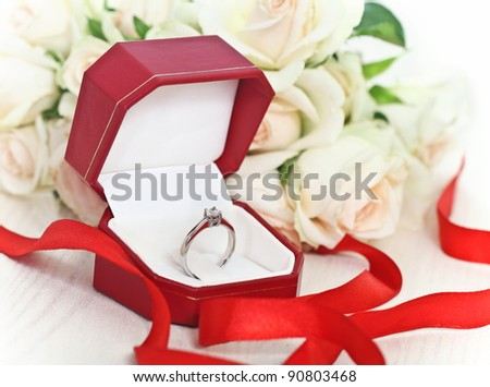 Marriage proposal. An engagement diamond ring in the box with roses