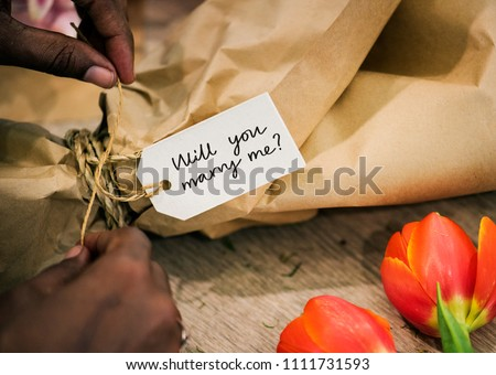 Marriage proposal tag on a flower bouquet