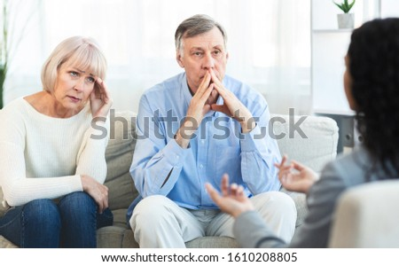 Marriage Therapy. Female psychologist consulting sad elderly couple, copyspace Stock photo ©