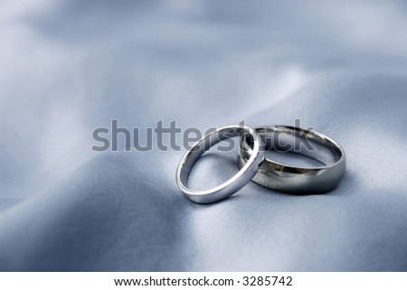 marriage - wedding bands on silk background