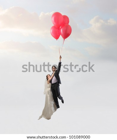 Married couple flying with some balloons