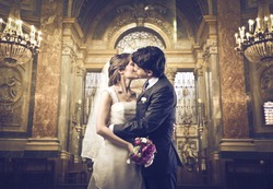 Married couple kissing in a church