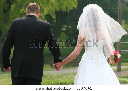 Married couple walking in a park