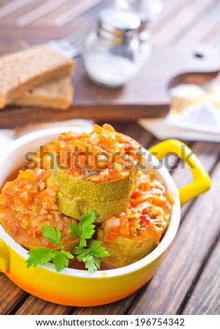 marrows stuffed with minced meat with sauce