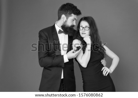 Marry me. Bachelor gives engagement ring to bride. Couple in love announce engagement. Engagement anniversary. Marriage proposal and engagement. #1576080862