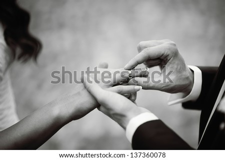Marry Me Today And Everyday, Hands Of A Wedding Heterosexual Couple. Groom Put A Ring On Finger Of His Lovely Wife.