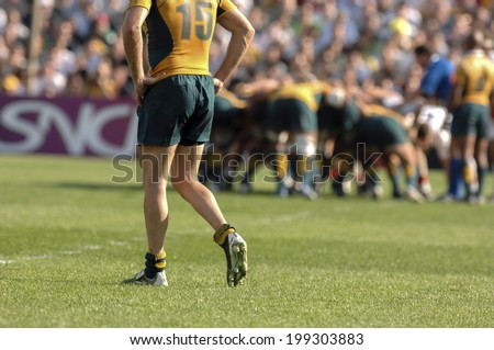 MARSEILLE, FRANCE-OCTOBER 06 2007: australian rugby player with scrum in the background, during the match Australia vs England, of the Rugby World Cup, in Marseille.