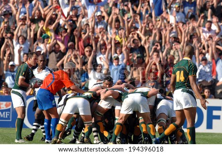 MARSEILLE, FRANCE-OCTOBER 07, 2007: rugby players scrum, with supporters cheering in the background, during the match Fiji vs South Africa, of the Rugby World Cup France 2007, in Marseille.