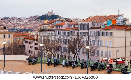 MARSEILLE, FRANCE, on March 2, 2018. A picturesque panoramic view of the city, the hill with cathedral Notr Dam de la Gard #1064326808
