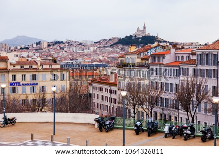 MARSEILLE, FRANCE, on March 2, 2018. A picturesque panoramic view of the city, the hill with cathedral Notr Dam de la Gard #1064326811